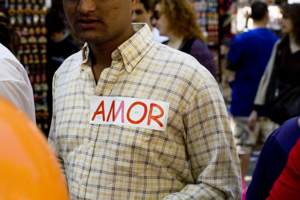 "Pakistanian man walking by ""Las Ramblas"" with a love sticker on her shirt. Today is the day of the love in Barcelona."